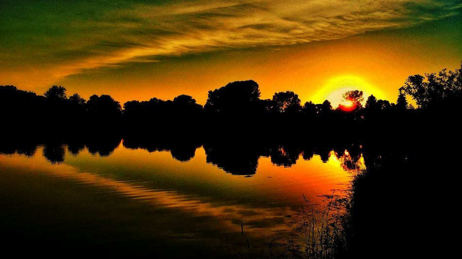 Sunset Reflection Nature Sky Scenics Lake Water Idyllic Silhouette Beauty In Nature Tree Tranquility Travel Dramatic Sky Outdoors Landscape Multi Colored No People Sun Reflection Lake Eye Em Nature Lover EyeEm Best Shots - Nature EyeEm Best Shots Pivitol Ideas TakeoverContrast