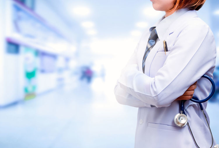 Midsection Of Female Doctor Standing In Hospital