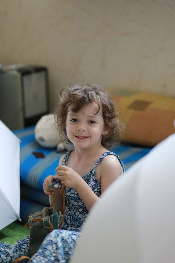 Portrait of smiling girl playing at home