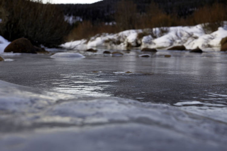 Frozen stream ice close-up. Beauty In Nature Close Cold Temperature Creek Day Frozen High Altitude Ice Landscape Mountains And Sky Nature No People Outdoors Stream Tranquility Water Winter Shimmer Sheen Surface Snow Rocky Mountain National Park Cold Perspectives On Nature