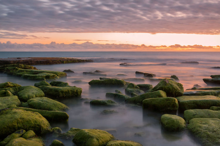Beauty In Nature Sunset Scenics - Nature Sea Rock Tranquility No People Cloud - Sky Horizon Over Water Horizon Sky Solid Rock - Object Idyllic Water Outdoors Tranquil Scene Nature Travel Destinations Travel Light Long Exposure EyeEmNewHere