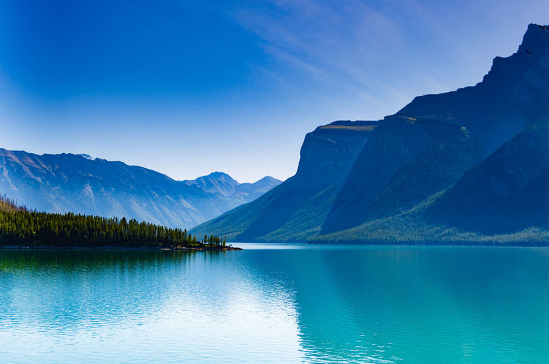 Lake Minnewanka in Banff National Park, Alberta, Canada Alberta Banff National Park  Reflection Beauty In Nature Blue Canada Day Idyllic Lake Mountain Mountain Range Nature No People Outdoors Reflection Scenics Sky Tranquil Scene Tranquility Water Waterfront