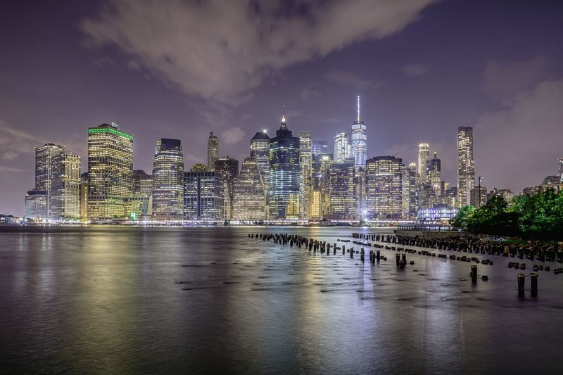 USA New York Manhattan Night Building Exterior Architecture Built Structure Building City Sky Water Office Building Exterior Skyscraper Cloud - Sky Illuminated Cityscape Landscape Reflection River Waterfront Nature Urban Skyline Modern Tall - High No People Outdoors Financial District  Spire