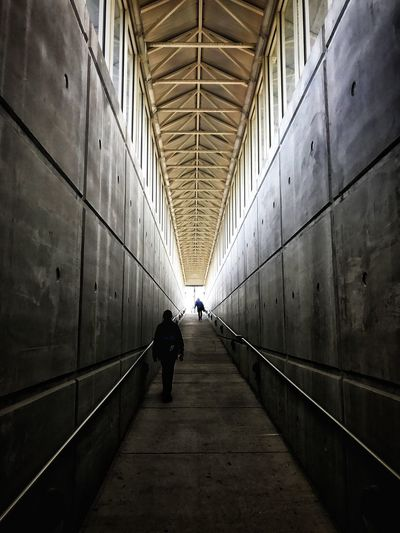 The Architect - 2017 EyeEm Awards Full Length Real People The Way Forward Walking Indoors  Men Architecture Built Structure One Person Tunnel Lifestyles Day Illuminated Adult Only Men People Adults Only Symmetry Symmetrical