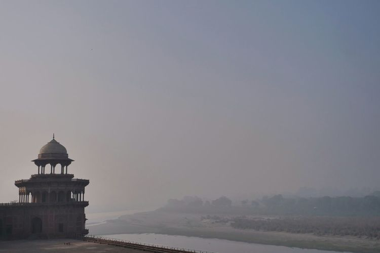 World Heritage Taj Mahal Agra Yamuna River India Dome Architecture Fog Built Structure Building Exterior Travel Destinations Tranquility Outdoors No People Water Day Sunset The Architect - 2018 EyeEm Awards