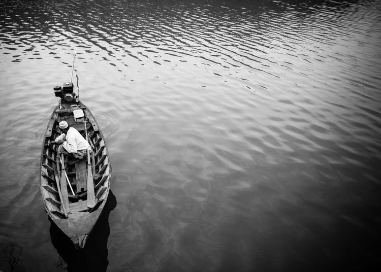 High angle view of man sitting in boat