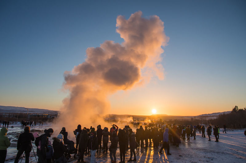 Geysir at Sunset at Strokkur, Iceland Geysir Hot Springs Geysir Strokkur Iceland People Watching Steam Strokkur Strokkur Geyser Sunset_collection Traveling Vapor Winter Destinations Erupting Eruption Fontaine Geysir Golden Hour Goldenhourphotography Iceland_collection Shillouette Sky Snow Sunset Travel Destinations Water
