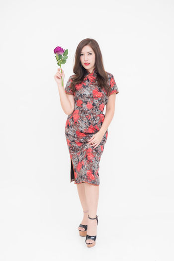 Adult Adults Only Beautiful People Beautiful Woman Beauty Day Fashion Fashion Model Flower Freshness Front View Full Length Glamour Looking At Camera One Person One Young Woman Only People Portrait Rose - Flower Standing Studio Shot White Background Young Adult Young Women