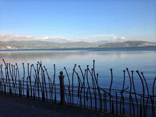 EyeEm EyeEm Best Shots EyeEm Best Edits Taking Photos Taking Pictures Blue Wave Metallic Fence Clear Sky Blue Sea Island Mountains In Ioannina , Greece