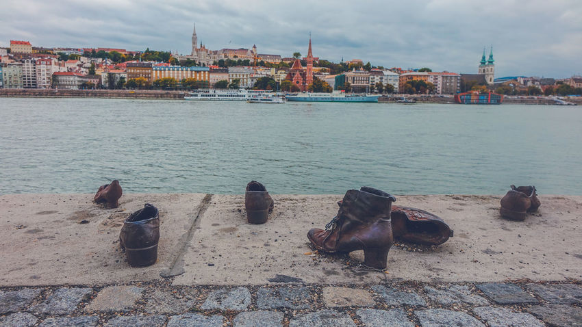 Shoes on Danube monument, Budapest, Hunagry Budapest Budapest Streetphotography Budapest, Hungary City Cityscape Danube Danube In Budapest Memorial Shoe Shoes ♥ Statue Cityview Danube River Monument No People Sculpture Shoes Monument Shoes On Danube Water