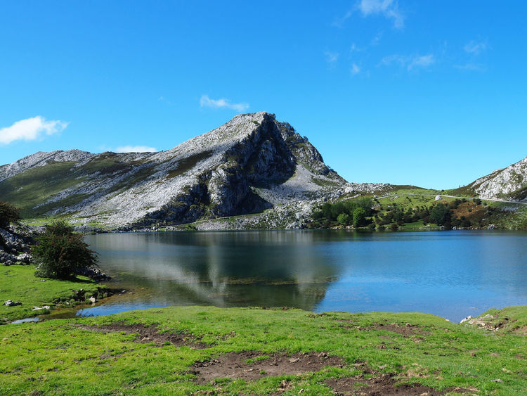 View of Enol Lake in Lagos de Covadonga, Asturias - Spain Asturias Lagos De Covadonga Picos De Europa Reflection SPAIN Travel Beauty In Nature Blue Covadonga Enol Lake Grass Lago Enol Lake Lakes  Landscape Mountain Mountain Range Nature No People Non-urban Scene Outdoors Peak Scenics Tranquil Scene Water