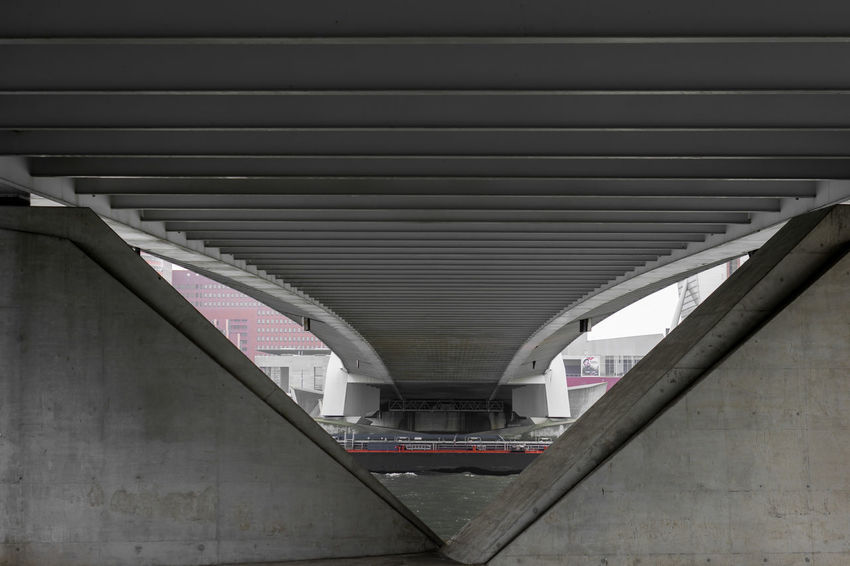 Erasmus Bridge The Architect - 2018 EyeEm Awards Architectural Column Architecture Bridge Bridge - Man Made Structure Built Structure Ceiling Connection Day Diminishing Perspective Girder Indoors  Low Angle View Metal Mode Of Transportation Modern No People Parking Garage Pattern Public Transportation Rail Transportation Transportation Underneath