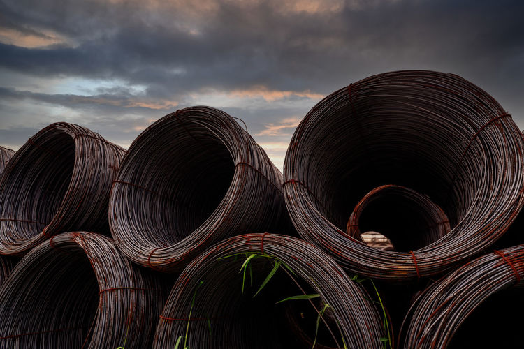 Steel wire coil against dark sky. metal steel reinforced for concrete construction. iron wire.