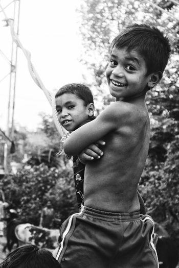 || Smile || Childhood Two People Baby Child Happiness Togetherness Smiling Love Portrait Cute Fun Cheerful Looking At Camera Standing Playing Boys Bonding That Smile  Smile That Smile  Black And White Blackandwhite Village Life Village Boy Villageboy EyeEmNewHere