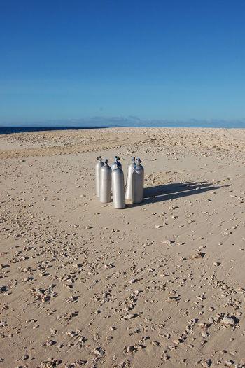 Scuba tanks Beachcomber Island. Fiji Sky Land Sand Nature Horizon Clear Sky Day Water No People Blue Beach Tranquil Scene Sea Scuba Tanks Beachcomber Island Fiji Tropical Island Holiday Destination