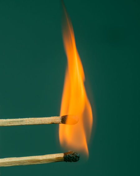 Close-up of fire against blue background