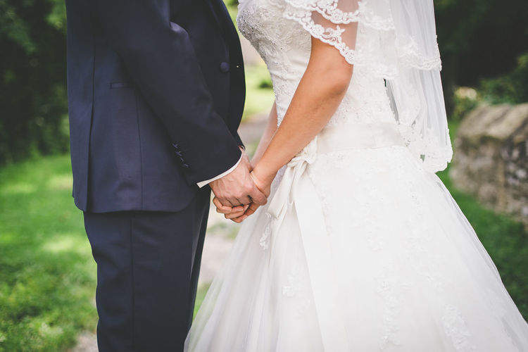 Bridal couple holding hands Couple Dress Holding Hands Kiss Relationship Suit Wedding Wedding Photography Bride Celebration Celebration Event Groom Heterosexual Couple Husband Love Married Men Trust Veil Wedding Ceremony Wedding Couple Wedding Dress Wife Women