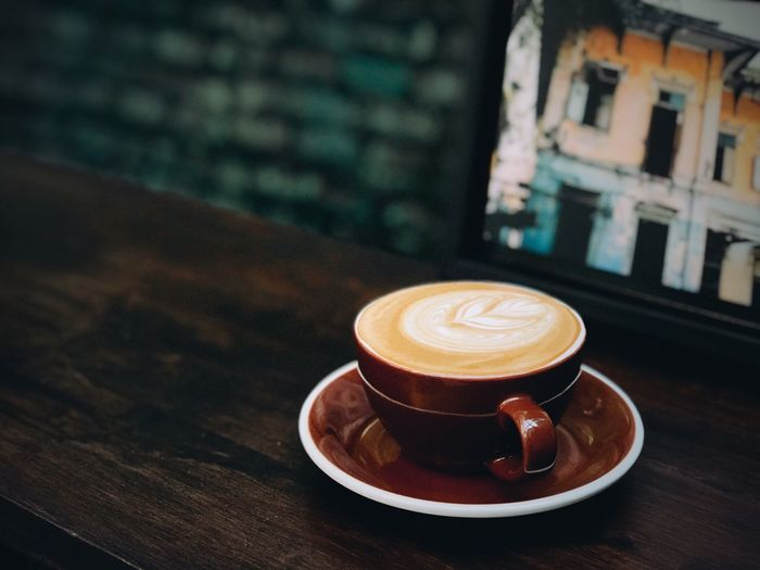 Coffee - Drink Drink Coffee Cup Refreshment Food And Drink Table Cappuccino Frothy Drink Saucer Froth Art Cafe Focus On Foreground No People Latte Close-up Indoors  Building Exterior Freshness Architecture Day