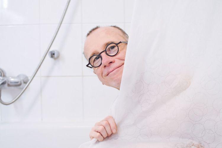 Portrait Of Man In Bathroom