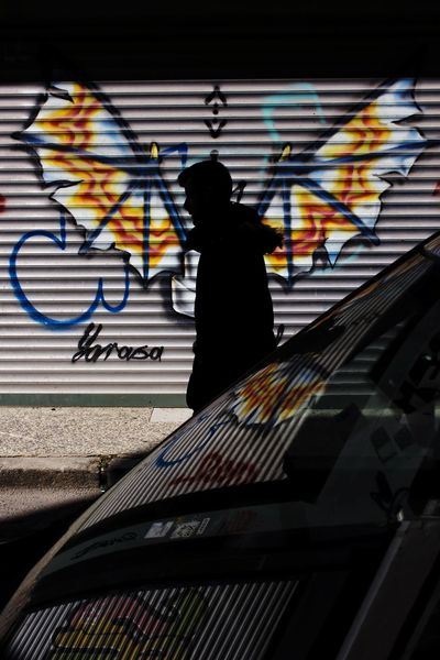 Wings of a silhouette 🦇 Streetphotography One Person Silhouette Urban EyeEm Istanbul Car Street Photography Street Waiting Reflection Colors Wing Wings