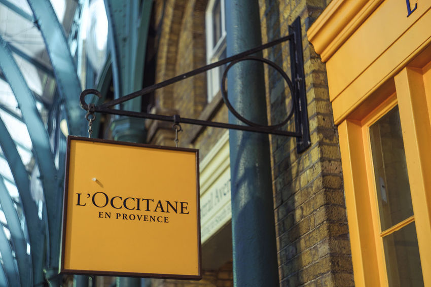 Architecture Brick Wall Building Built Structure City Close-up Commerical Focus On Foreground Information Sign Loccitane Low Angle View No People Shop Shopping Showcase August Yellow