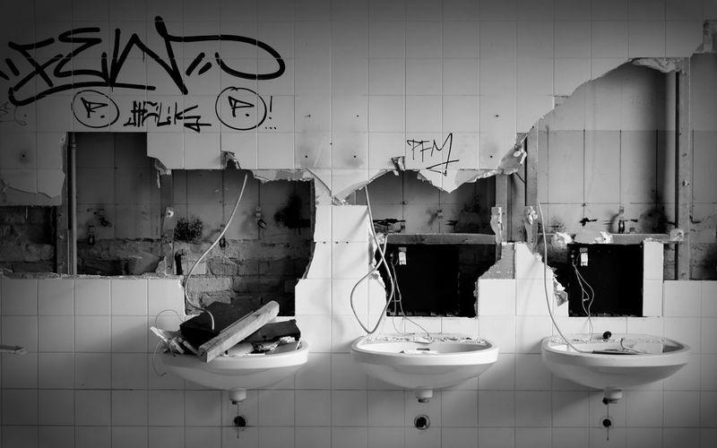 Interior of broken public rest room