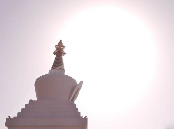 The Enlightenment Stupa of Benalmádena. According to the Buddhist teachings there are eight different types of Tibetan Stupas. Each of them represents an important event of the historical Buddha Shakyamuni's life story. The Enlightenment Stupa symbolizes the achievement of Buddha's enlightenment, the nature of a fully awakened mind. Architectural Feature Architecture Blue Budist Budist Tempel Built Structure Day High Section Low Angle View Mantras Nature No People Outdoors Philosophy Quiet Mind Sky Stupa Nepal Stupas Sun Sunbeam Sunny Temple - Building Tibetan Buddhism Tourism Travel Destinations
