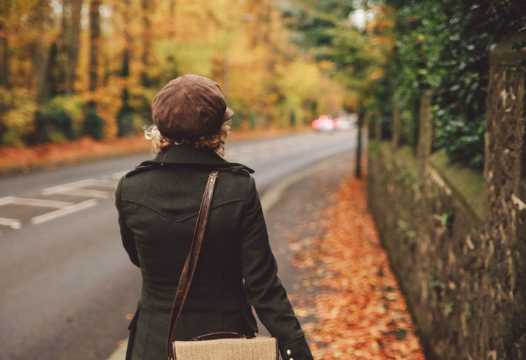 Autumn Road Autumn Curly Hair Day Epsom Focus On Foreground Forest Girl Had  Leisure Activity Lifestyles Nature One Person Outdoors People Real People Rear View Road Standing The Way Forward Transportation Tree Uk Walking Young Adult Autumn Mood British Culture