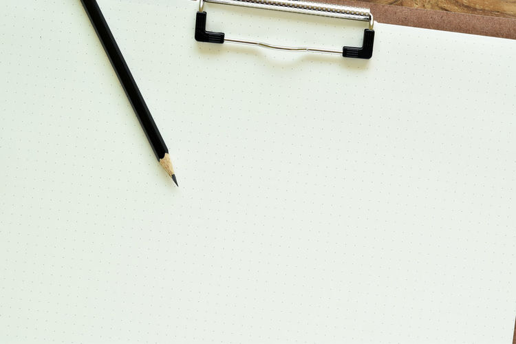 High angle view of pencils on white table