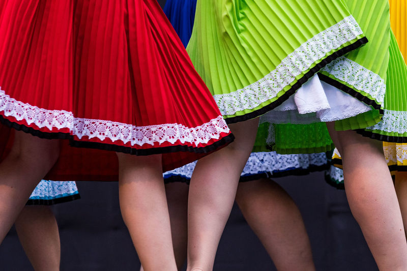 Midsection of woman wearing colorful skirts outdoors