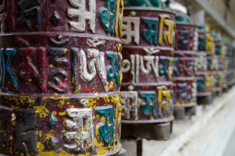 Close-up of graffiti on rusty metal