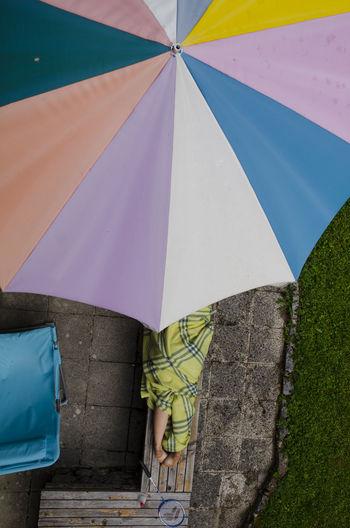 Two legs peacefully resting under a parasol. The Street Photographer - 2018 EyeEm Awards Eyeem Streetphotography Street Street Photography