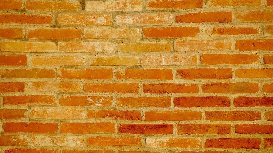 Full frame shot of red brick wall