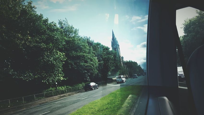 Thinks100 day 39. Behind Me On The Road In The Car View Blue Skies Spire