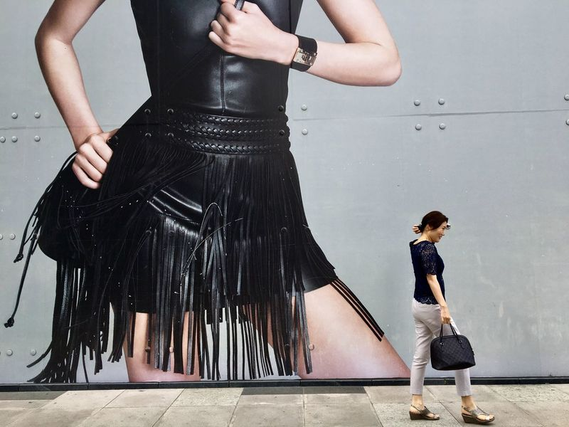 A woman walks past a fashion wear outlet advertisement at Bonifacio Global City in Taguig, Metro Manila. Full Length Standing Holding Outdoors Fashion Advertisement Billboard Streetphotography Philippines Manila Lifestyles Taguig Apparel Clothing Fashionista