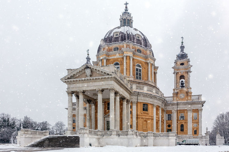 Image of the Basilica of Superga Turin in winter, Piedmont, Italy Basilica Church Superga (To) Architecture Baroque Style Building Exterior Built Structure Cold Temperature Day Dome History Nature Outdoors Place Of Worship Religion Sky Snow Snowing Spirituality Tourism Travel Travel Destinations Turin Weather Winter