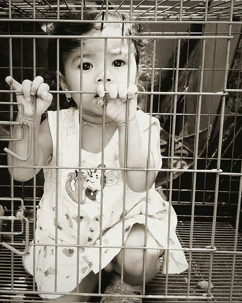 Image of a girl in the cage. reminds us as parents to not restrict children from their talents.First Eyeem Photo Kids Parenting Kids Photography The Message Model Girl Children Deannauvhotography