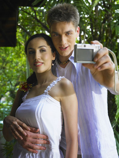 couple enjoying honeymoon at resort Content Holiday Romance Vacations Bonding Couple - Relationship Enjoying Life Enjoyment Hapiness Happiness Holding Honeymoon Hotel Leisure Activity Lifestyles Looking At Camera Love Luxury Outdoors Pleasure Resort Selfie Smiling Togetherness Two People