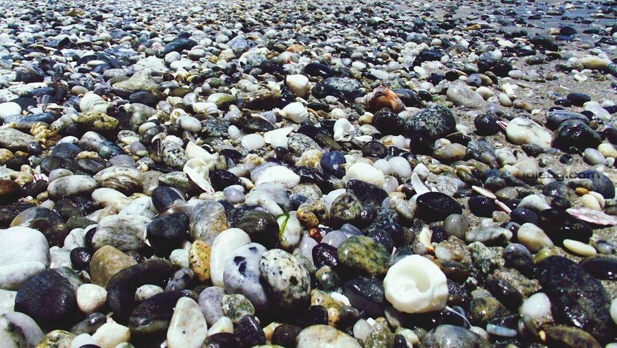 Full frame shot of stones on shore