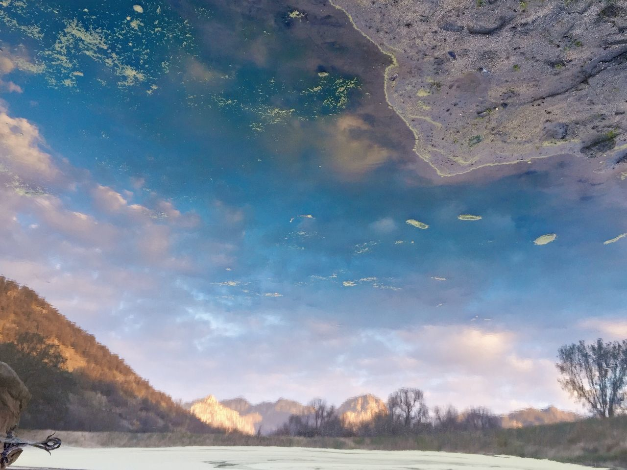 Reflection Of Mountains Against Sky On Calm Lake During Winter
