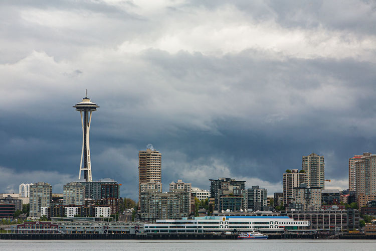 Seattle skyline with modern buildings against ominous clouds in background