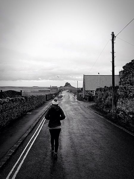 Holy Island Castle Ruins Perspective Distance Woman Walking Blackandwhite Fine Art Photography On The Way Women Who Inspire You Lindisfarne Travel Travel Destinations The Way Forward Road Taking Photos Walking Around People Together People And Places Monochrome Photography