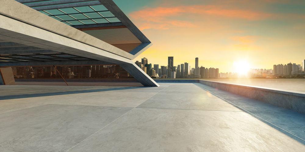 Modern building against sky during sunset