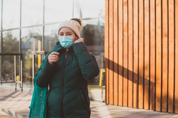 Woman in warm clothing during pandemic