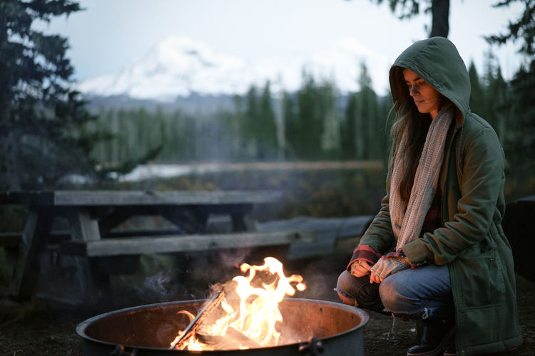 Woman sitting on bonfire