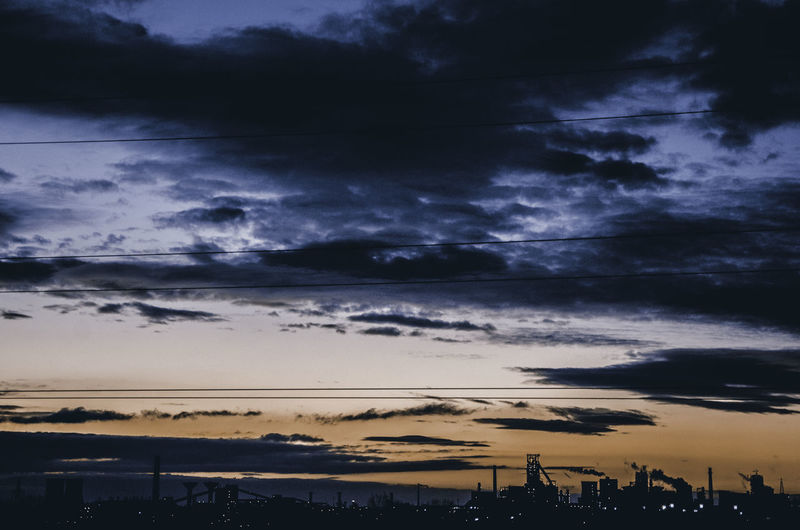 Atmosphere Atmospheric Mood Cloud Cloud - Sky Cloudscape Cloudy Distant Dramatic Sky Light Majestic Moody Sky Orange Color Outdoors Silhouette Sky Storm Cloud Sun Sunset Weather