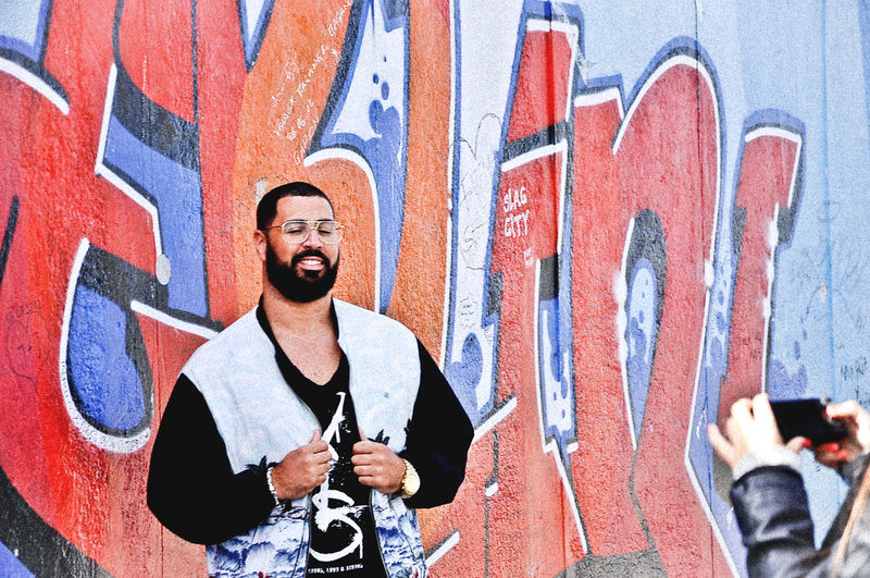Architecture Art Berlin Berlin Wall Berliner Mauer Black Built Structure Casual Clothing Day German Germany Graffiti Graffiti Art Graffiti Wall Leisure Activity Lifestyles Multi Colored Outdoors Portrait My Favorite Place Battle Of The Cities People And Places