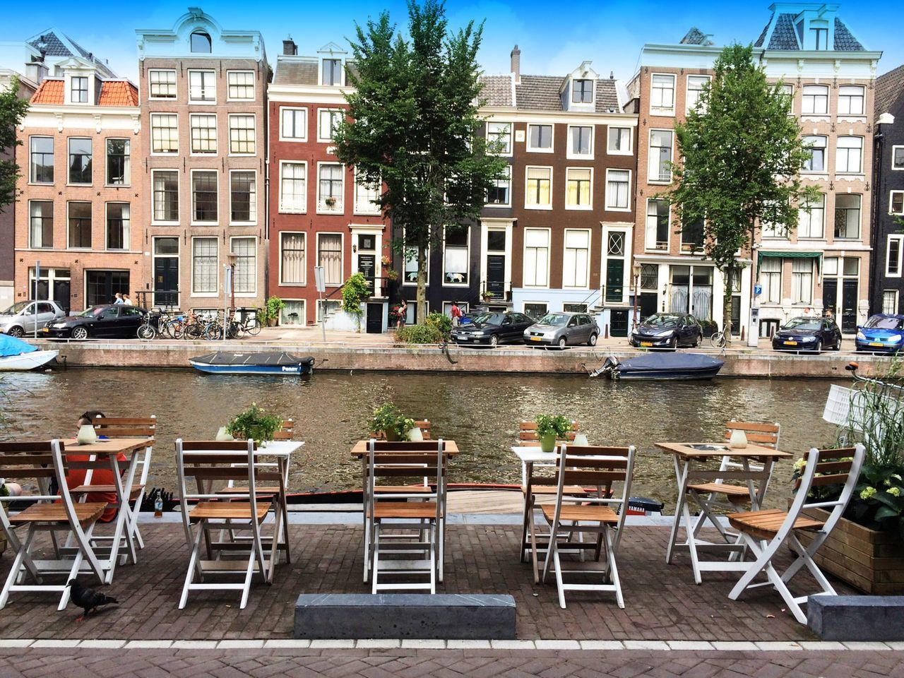 Empty sidewalk cafe by canal