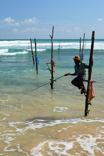 Stilt fisherman. Weligama. Sri Lanka Asian  Indian Ocean Life Style Matara Sri Lanka Stilt Fisherman Tradition Traditional Fishing Workers Ceylon Fisherman Fishing Outdoors Scenics Sea Seascape Tourism Destination Traditional Travel Destinations Weligama