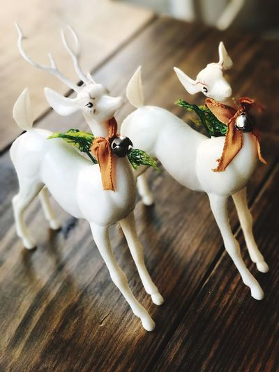 Vintage Christmas Plastic Reindeer Animal Representation Table Indoors  No People High Angle View Close-up Figurine  Celebration Animal Themes Reindeer Vintage Reindeer Vintage Retro Vintage Christmas Vintage Christmas Decorations White Plastic Holiday Christmas Reindeers White Reindeer Christmastime Antlers Broken Antlers